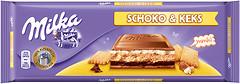Фото Milka молочный с печеньем и шоколадно-сливочной начинкой 300 г