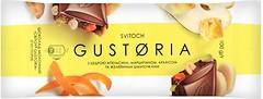 Фото Світоч молочный Gustoria с цедрой апельсина, марципаном, арахисом и желейными кусочками 100 г