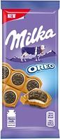 Фото Milka молочный с начинкой ваниль и печеньем Oreo 92 г